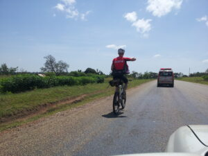 Tourist-on-bicycle-trip-in-Western-Uganda